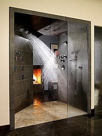 Elegant Multi Head Shower With Heated Tile Floors, Fires, And Heated Towels Rings.