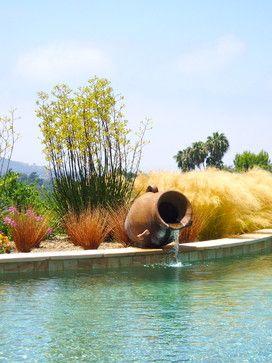 Building a swimming pool waterfall swimming pools spas for Swimming pool waterfalls construction