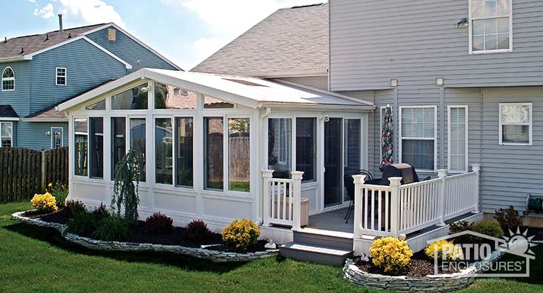 White vinyl frame four season room with gable roof and for 4 season sunroom