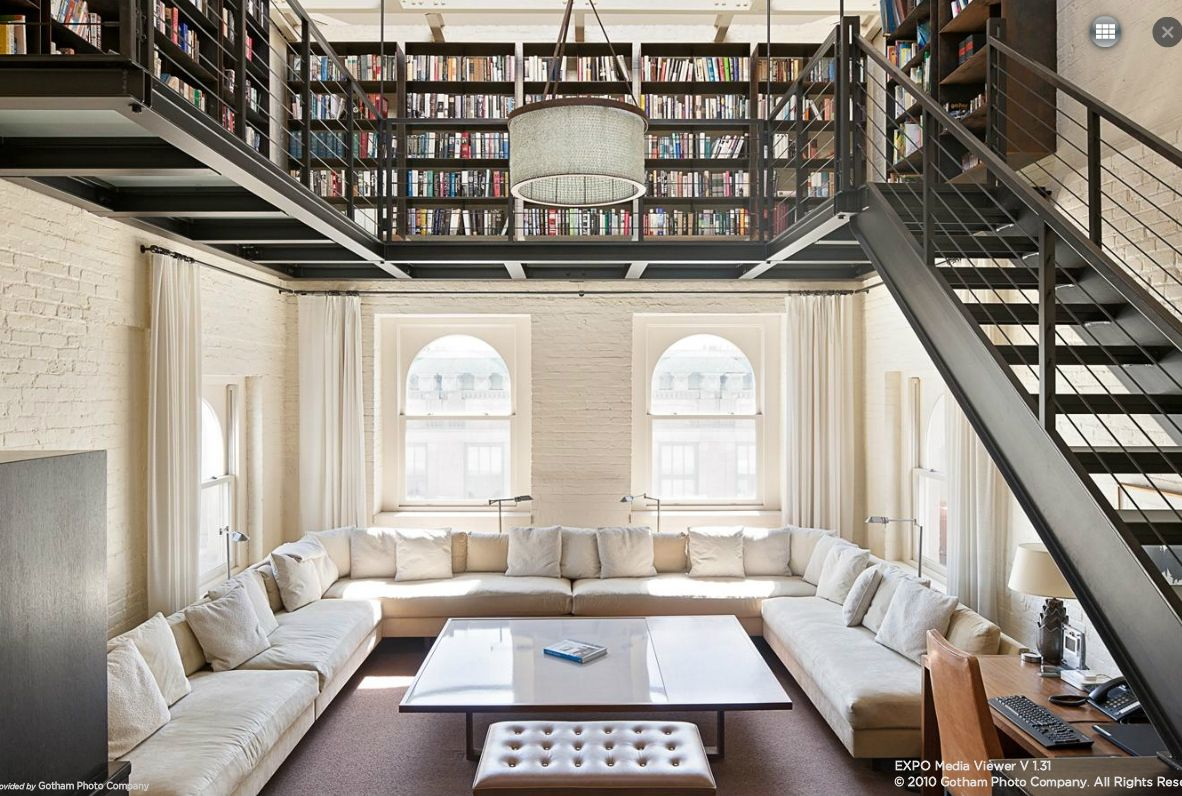 Love this. White couches, mezzanine  library. Just have to wait for the kids to grow up!