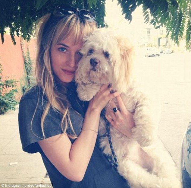 Cute: Jordan Masterson posted a picture of girlfriend Dakota Johnson with a pet pooch