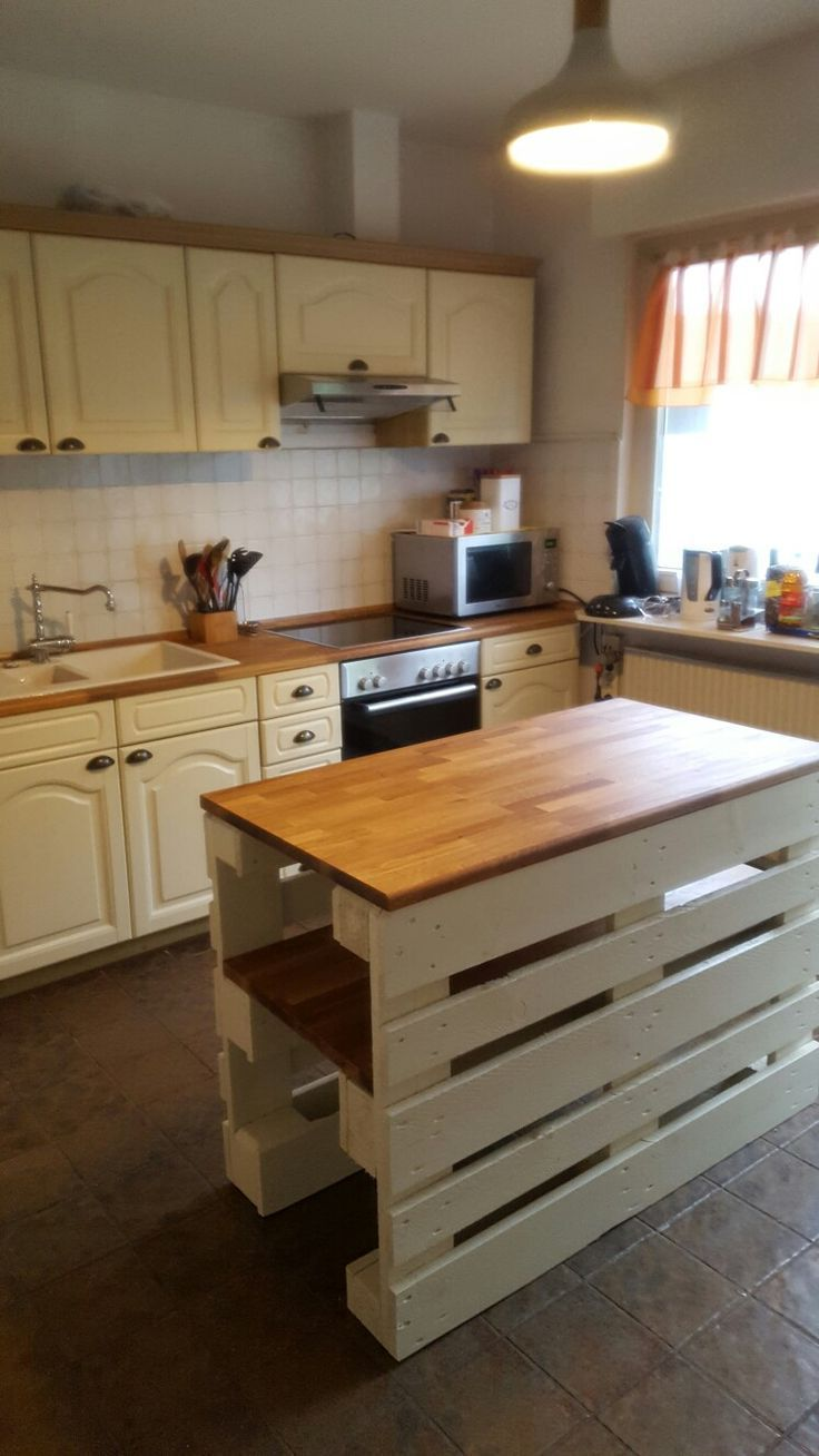 Photo of Country kitchen island made of pallets