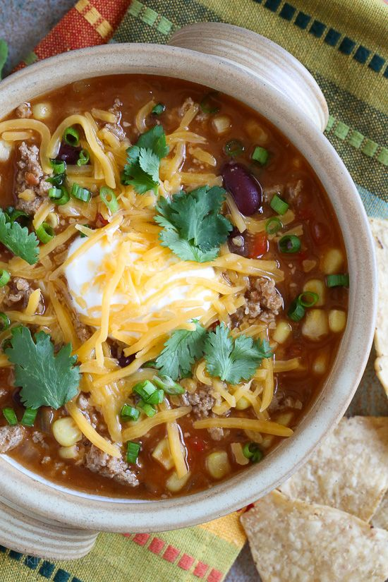 This quick turkey chili taco soup satisfies my soup cravings, takes just 20 minutes to cook but it tastes like it was simmering for hours! Top it with your favorite chili toppings such as sour cream, cheese or whatever you like for a healthy meal that can be prepped for the week or frozen for another night.