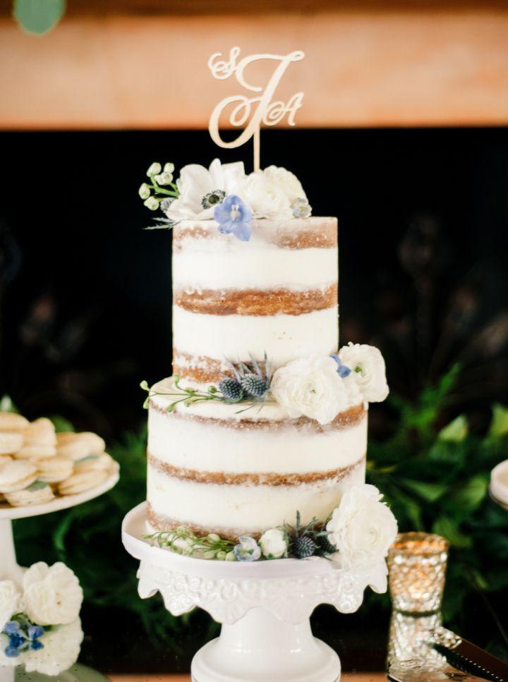 Two tier naked wedding cake | unfrosted wedding cake #weddingcake #weddingdesserttable