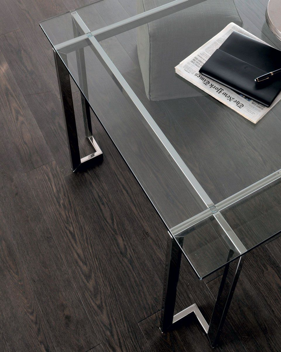 Lord - Table with transparent glass top. Structure in bright stainless steel.