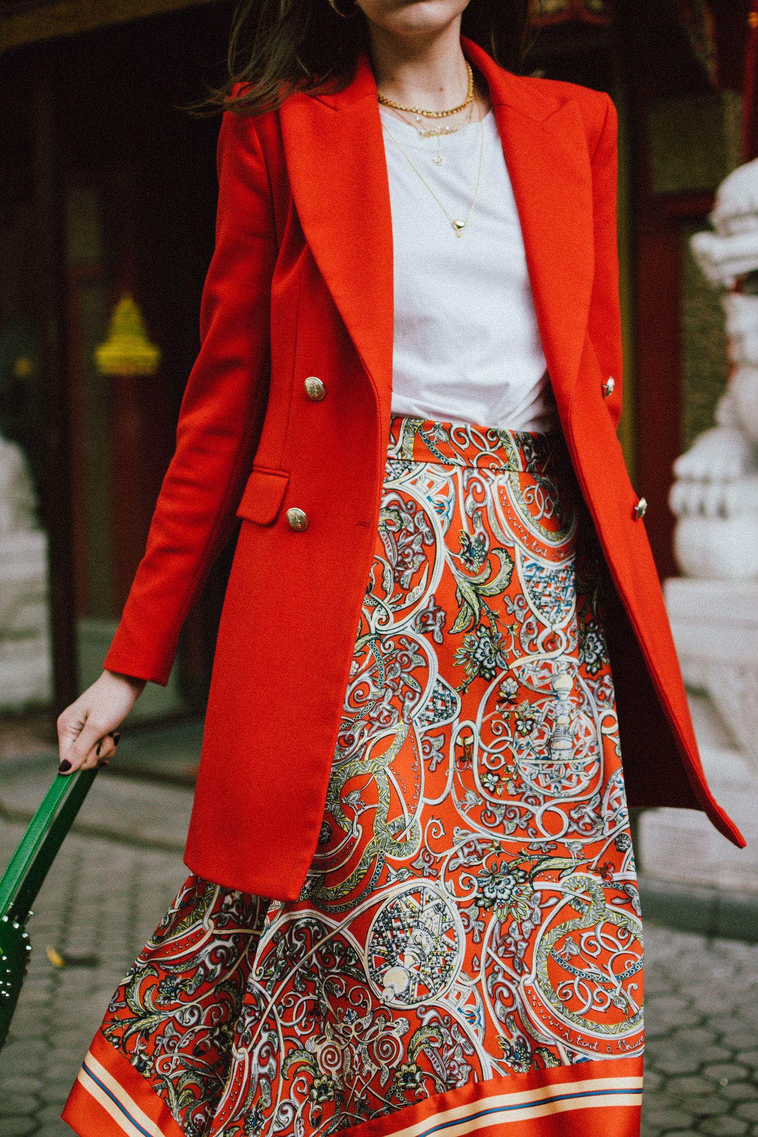 38ea5c0107da Zara double breasted long orange blazer, h&m patterned orange asymmetric midi  skirt, gucci white and red leather sneakers, prada green saffiano leather  ...