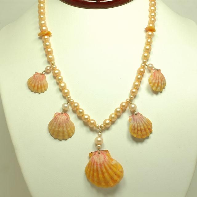 A 16 inch sunrise sea shell and pearl necklace in 14K yellow gold, from our designer collection.