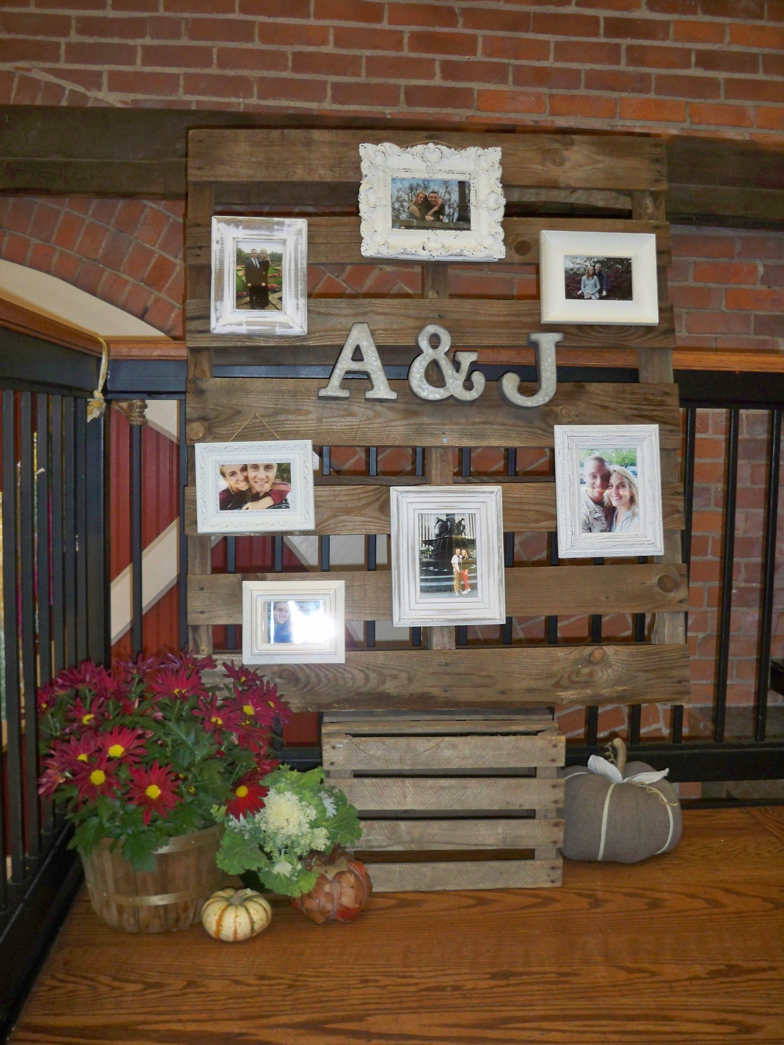 Pallet with pics of bride and groom