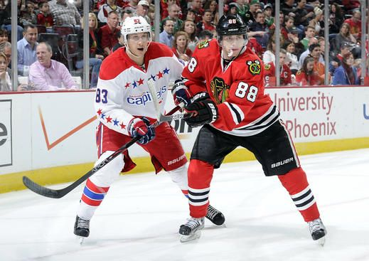 94847625a Patrick Kane #88 of the Chicago Blackhawks and Jay Beagle #83 of the  Washington Capitals wait in position for the puck during the NHL game on  March 18, ...