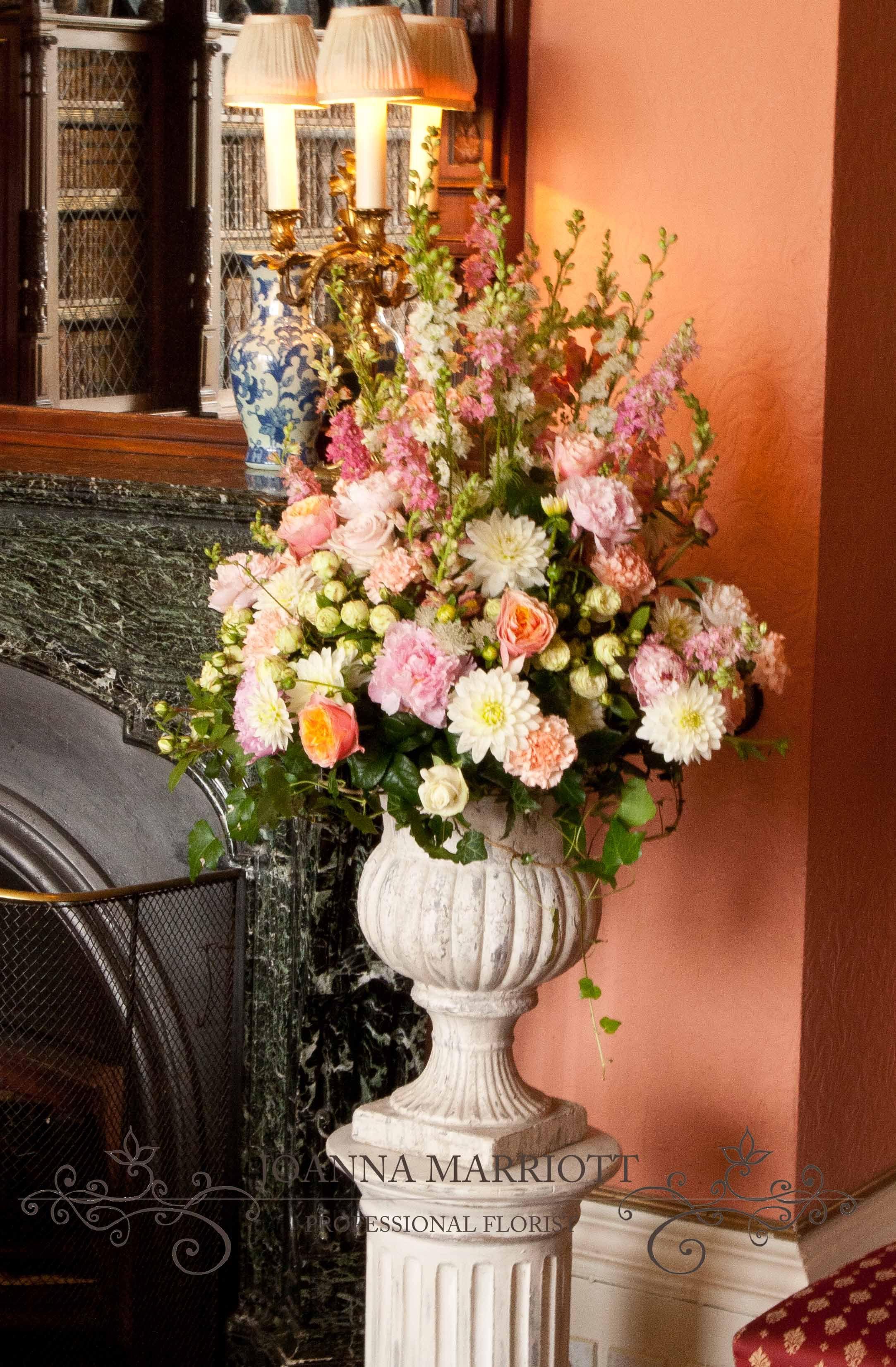 Peach, pale pink, cream pedestal arrangement. Wedding
