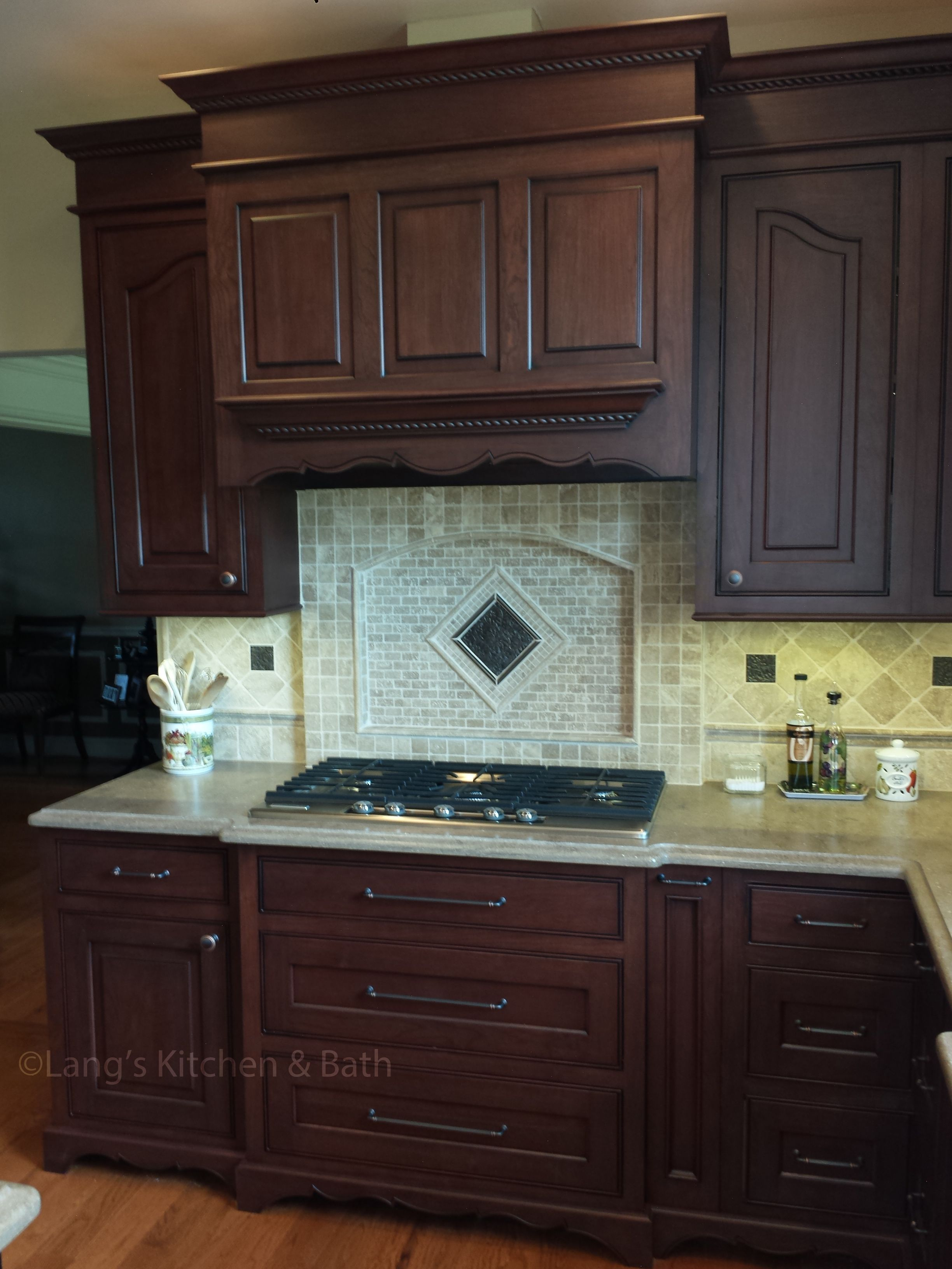 The Contrasting Cherry And Black Jay Rambo Kitchen Cabinets Give A  Sophisticated Backdrop To An Array