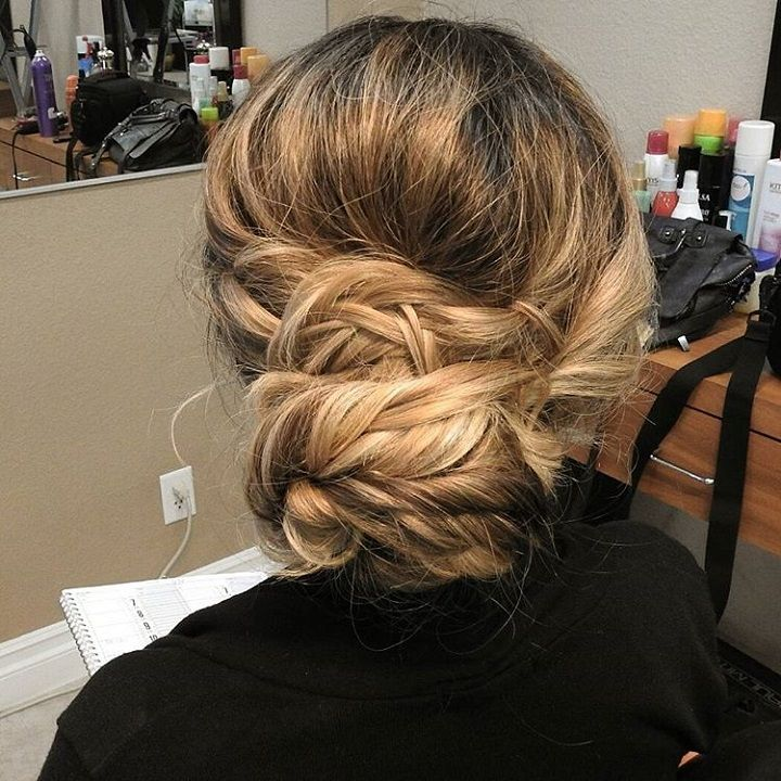 messy updo with braid wedding hairstyle