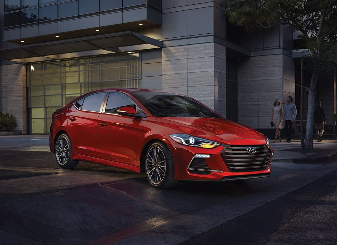 Image of a fiery red 2017 Hyundai Elantra on a dark city