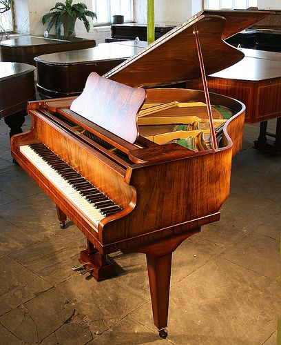 In Grand Pianos The Frame And Strings Are Horizontal