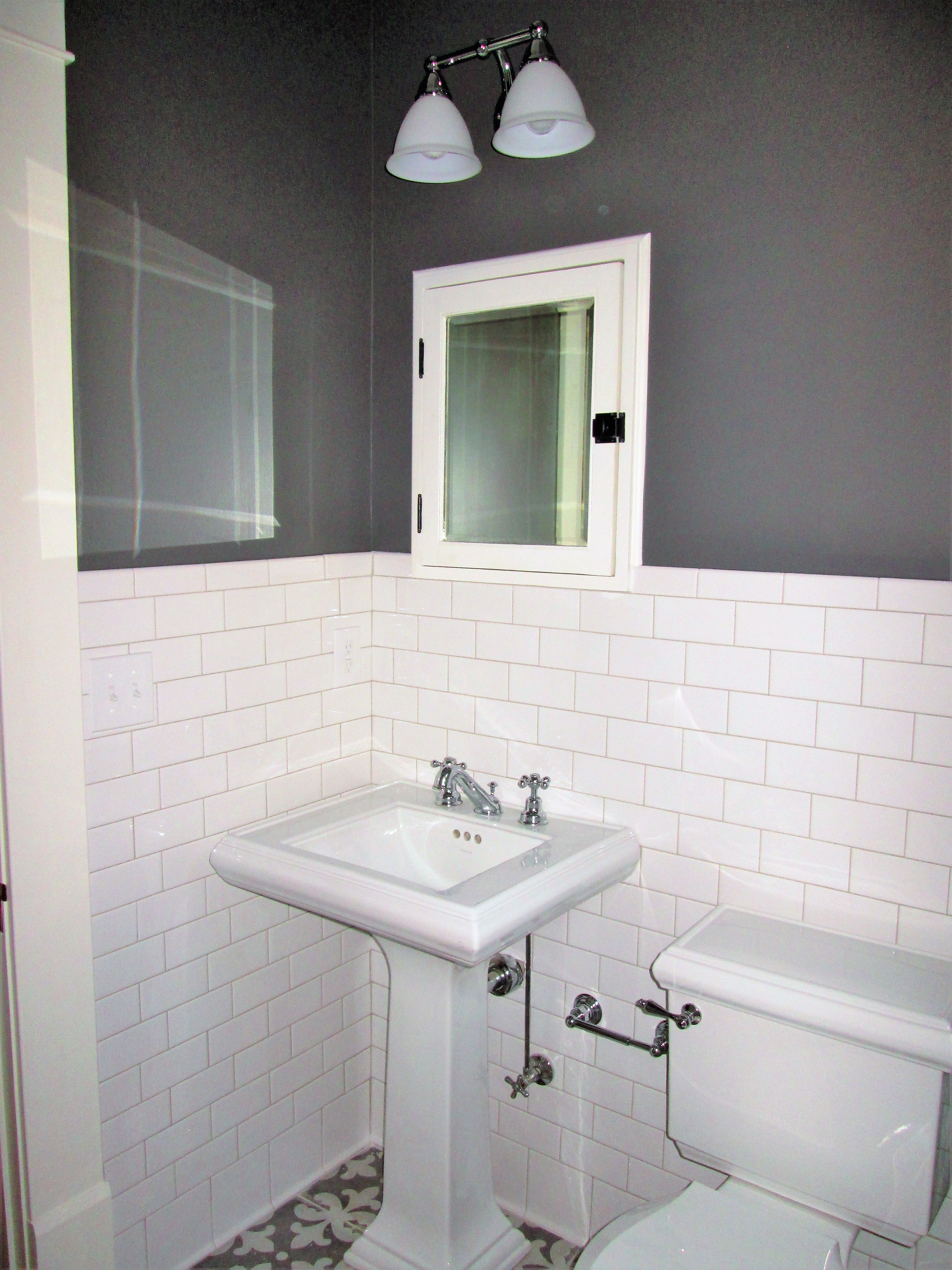Small bath remodel in gray and white with pedestal sink inset