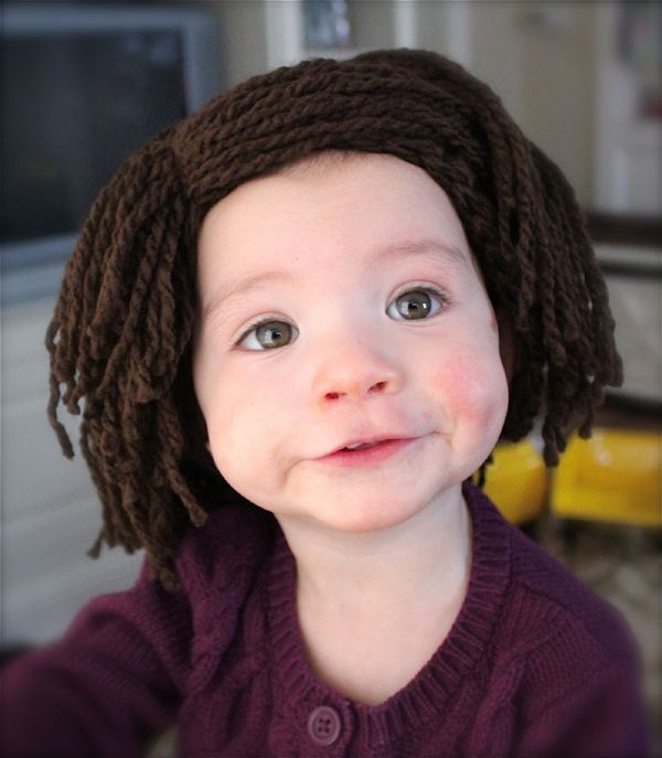A knit wig hat for a bald toddler.