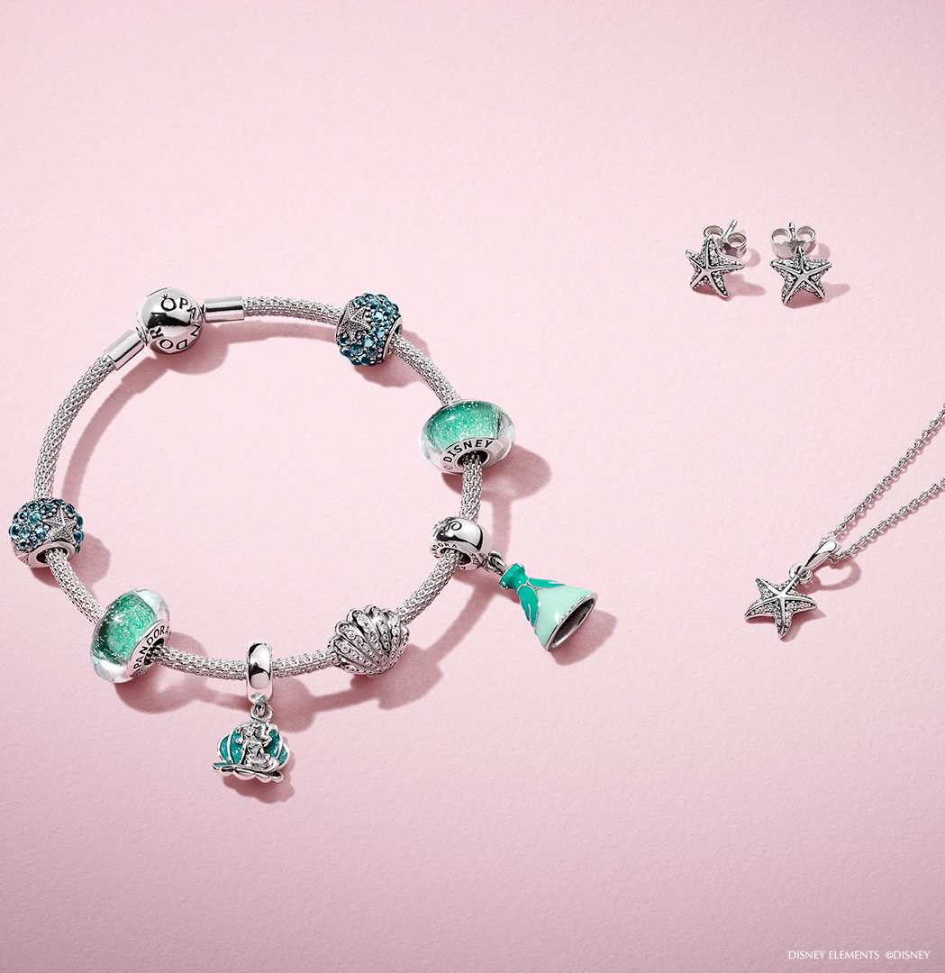 2d0691a5f Make a splash with PANDORA Disney sterling silver charms inspired by the  Little Mermaid. Pick your favourites from sparkling seashells to Ariel's  aqua green ...