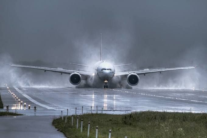 riders of the storm boeing 777 landing at chopin airport. Black Bedroom Furniture Sets. Home Design Ideas