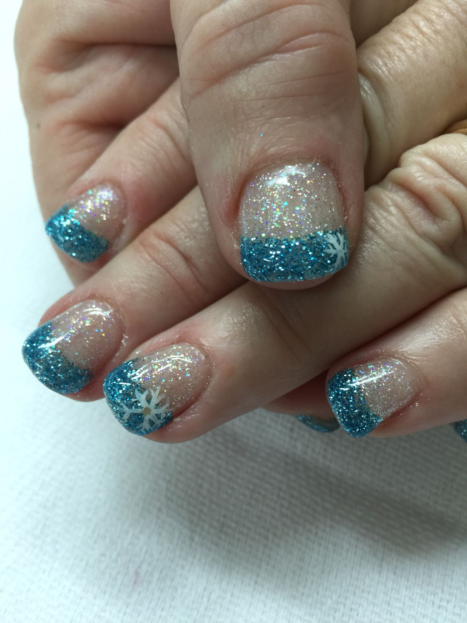 Winter frozen blue and clear glitter snowflake French gel nails. All ...