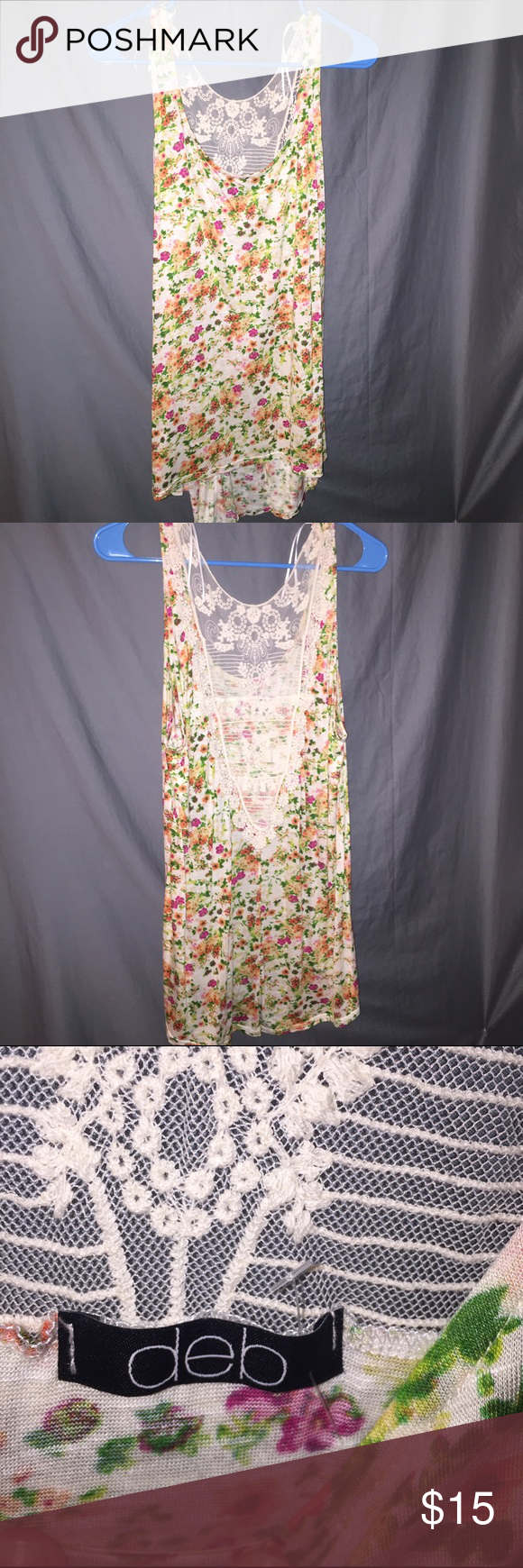 Floral Print top w/ Lace Back Plus Size Floral print top with lace back.  Never worn but no tags. Very Slight high low style, covers all of belly! Size 2x (xxl) bundle for best deals! 🌻🌷🌼🌸 bought from Deb Boutique in San Antonio Deb Tops