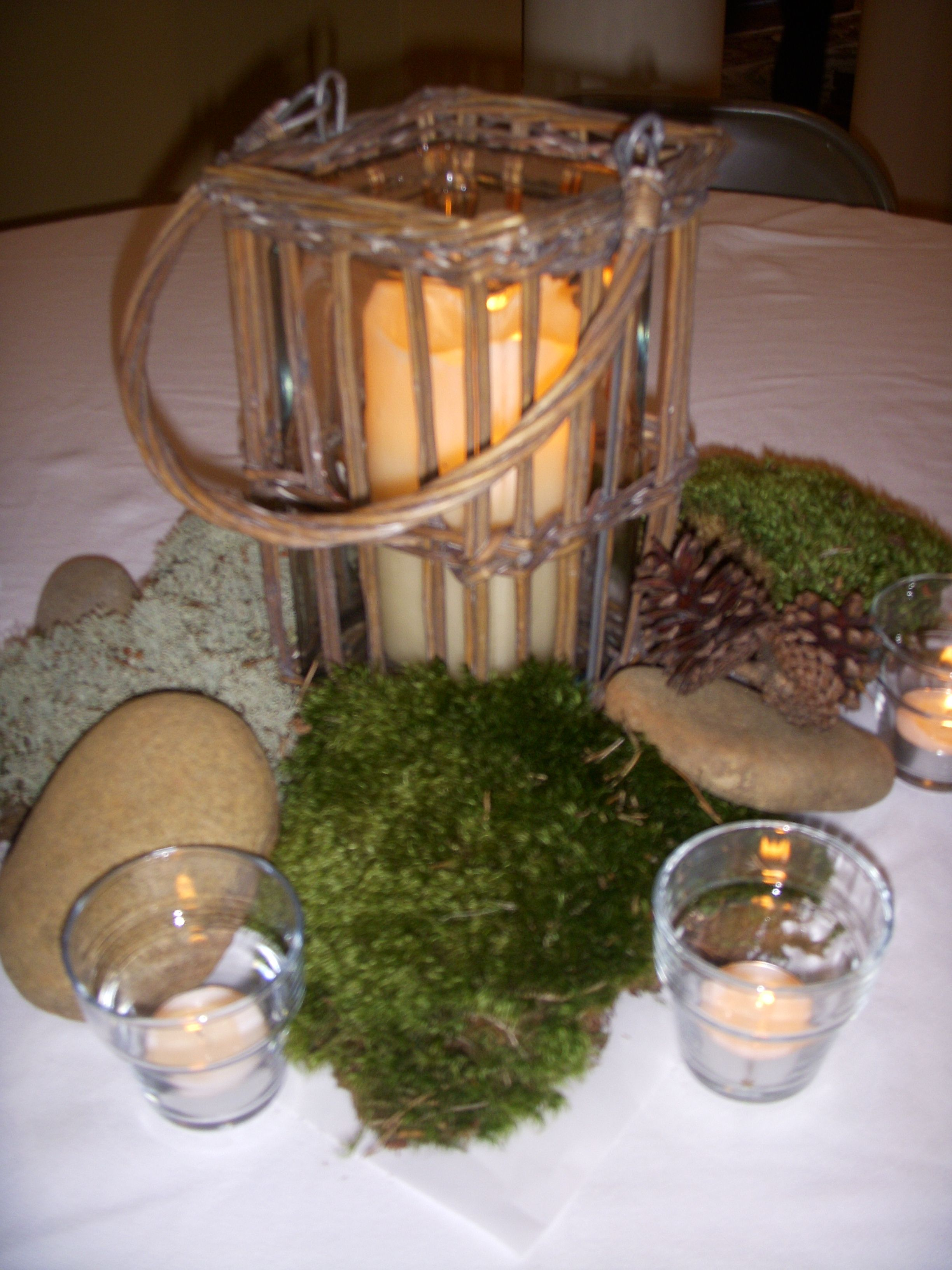 centerpieces made from river rock and moss picked up from the great