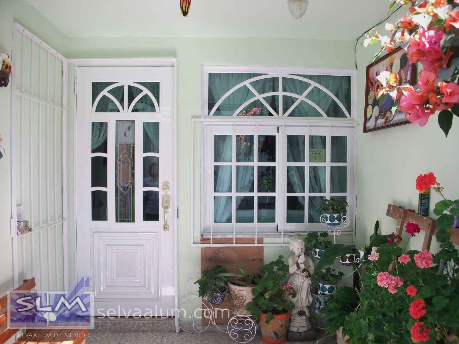 Selvaalum puertas y ventanas de aluminio linea espa ola for Puertas prefabricadas precios