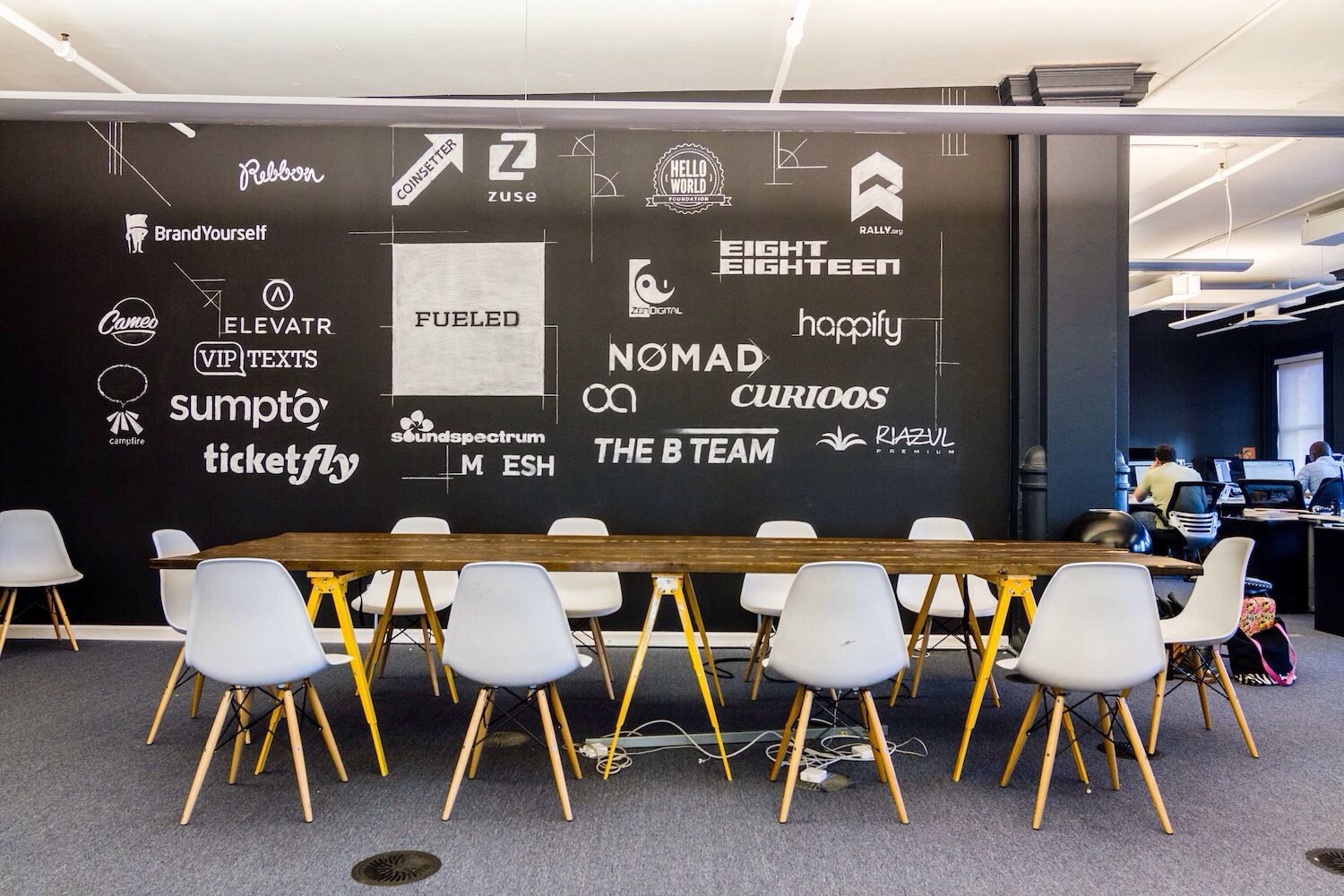 Coworking Space. Sponsorship Wall And Sawhorse Table. Great Pictures