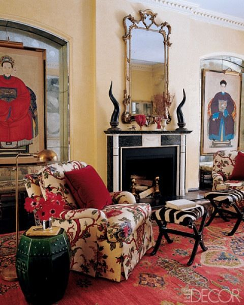The red rug, flowers, pillows and Chinese ancestor ...