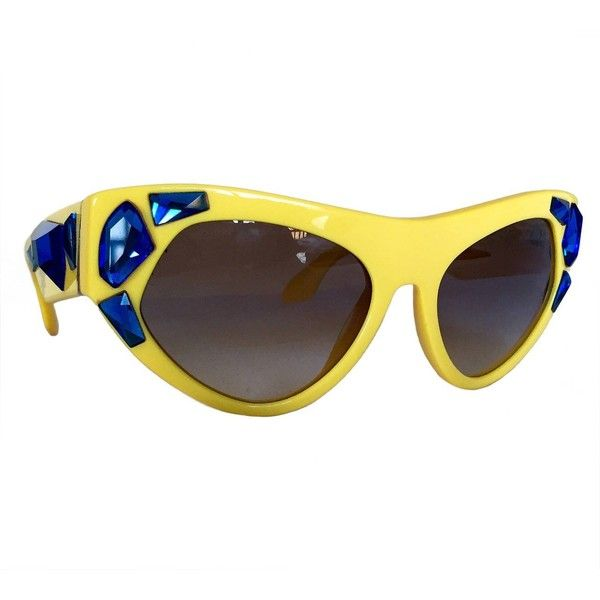 44c8ad8b089a4 ... sale impossible to find prada voice cat eye yellow sunglasses 2014  campaign liked on polyvore featuring