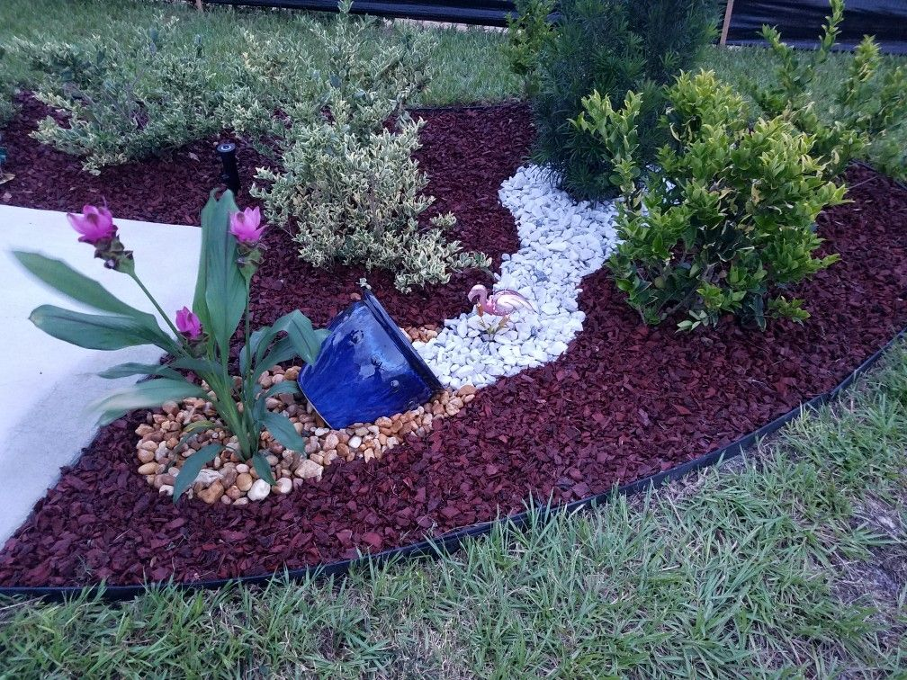 Rubber Mulch Gurcuma Flowers Egg Rocks And White Marble Chips