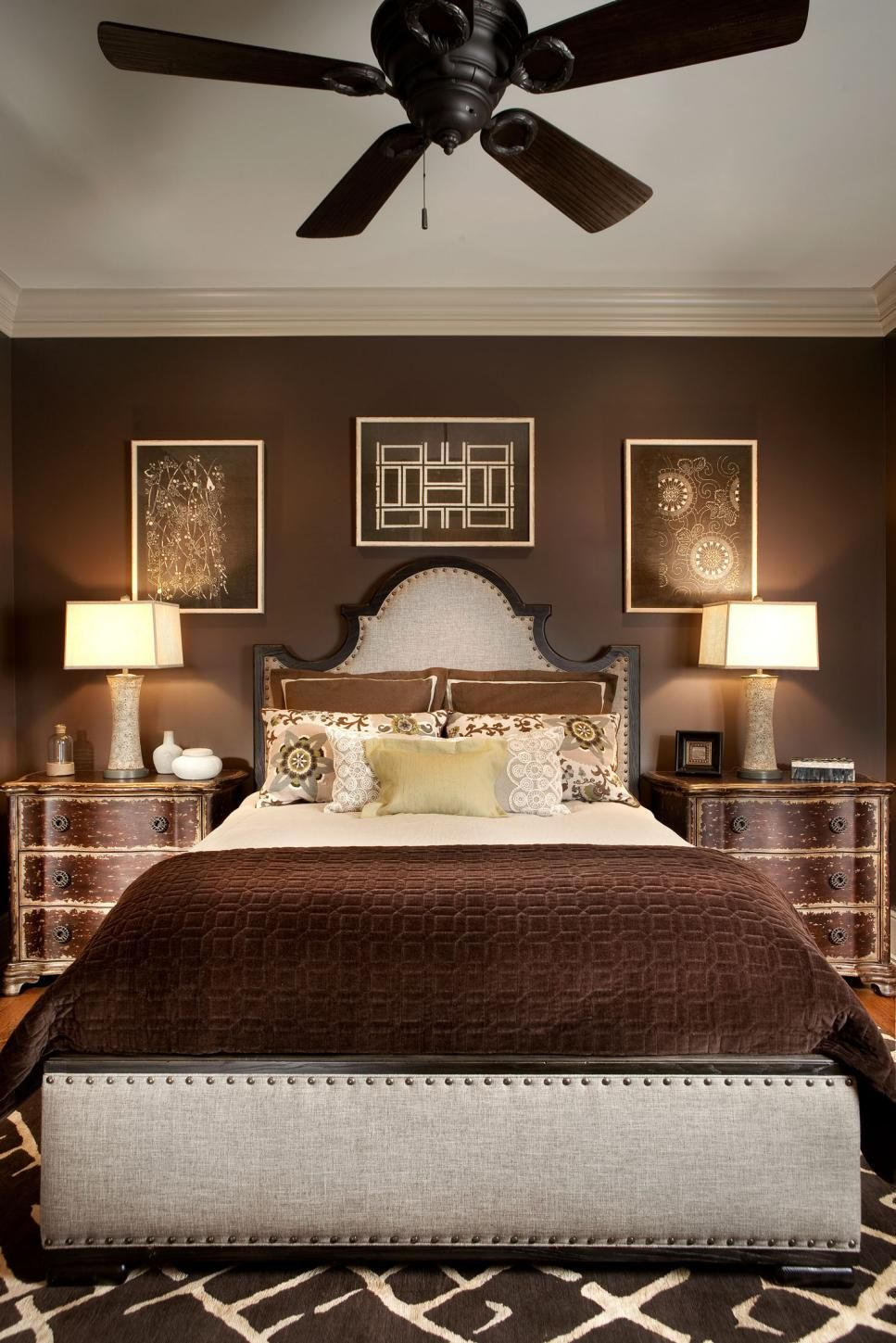 Rich Chocolate Brown Encompasses This Bedroom, Including The Linens, Rug,  Nightstands, Walls
