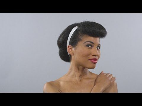 You might remember a video of a model going through 100 years' worth of hair and makeup trends in just one minute. Now, the producers have recreated the video with an African-American model.