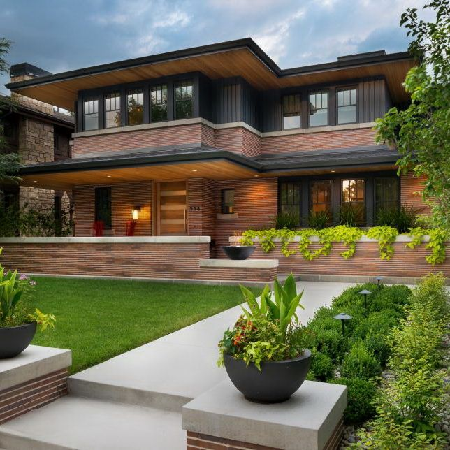 The Organic Landscape And The Kenneth Cobonpue Yoda Easy Chairs In Bright Red Frame This Frank Lloyd Prairie Style Houses Frank Lloyd Wright Craftsman Exterior