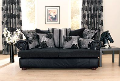 Cly Looking Living Room With Out The Horse Head Using A Black Leather Couch Pillows Make It Look Warm And Inviting Instead Of Very Male Cold