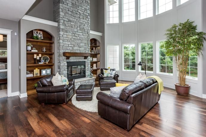 curved great room window, arched drywall built ins | Built ...