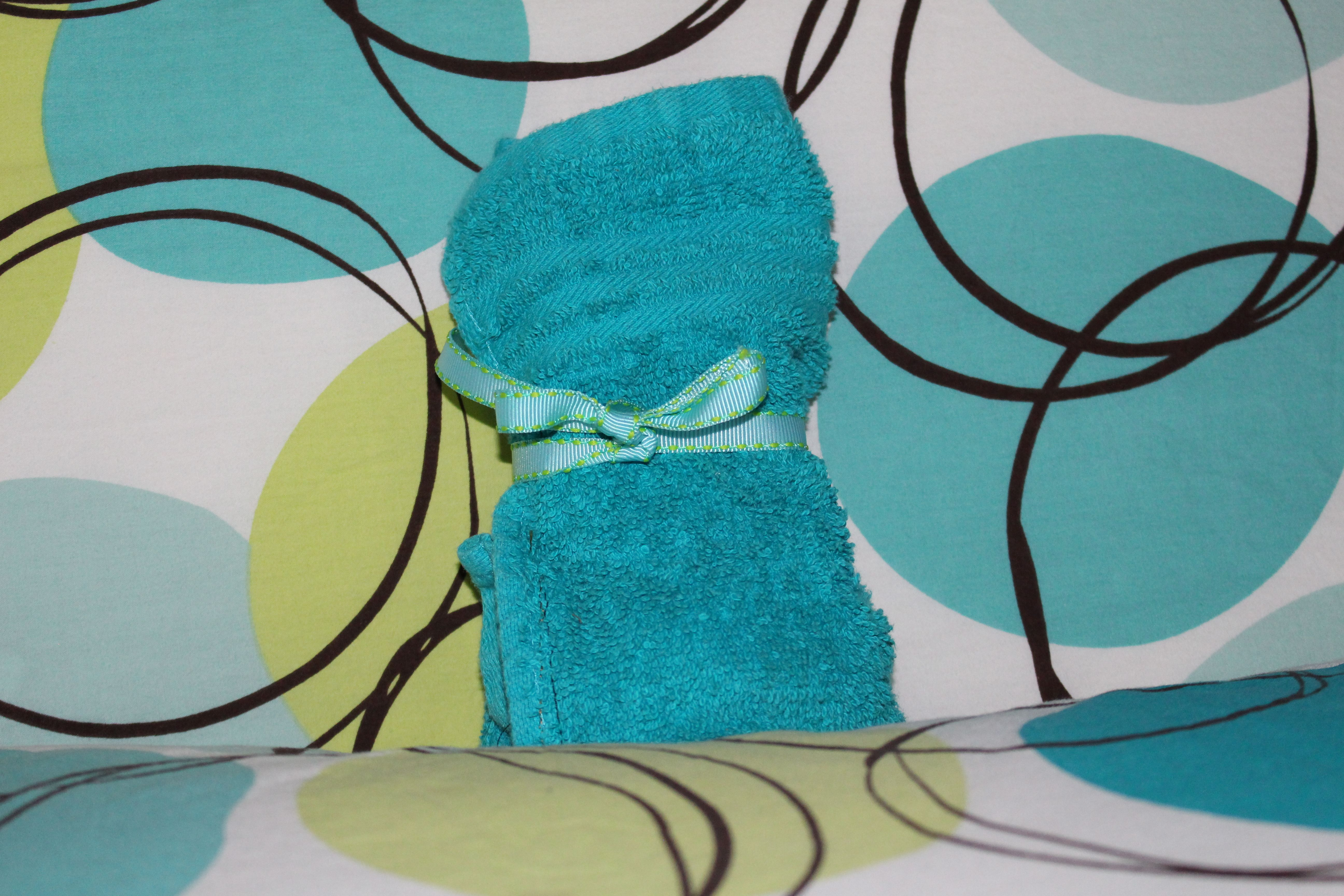 Terry Cloth Travel Towel to hold hygiene supplies when traveling
