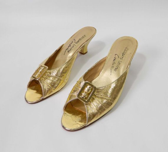 Not my size but I'm a sucker for anything metallic!  Gold Shoes Kitten Heels Vintage 1970s Size 85 by WearitWellvintage, $27.00