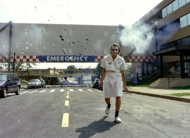 Joker walking after blowing up the Gotham Hospital
