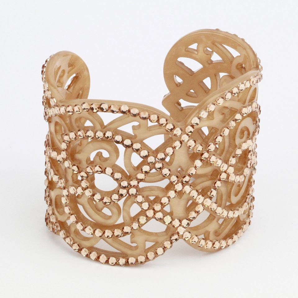 Rococoinspired bejeweled gold cuff with interweaving design