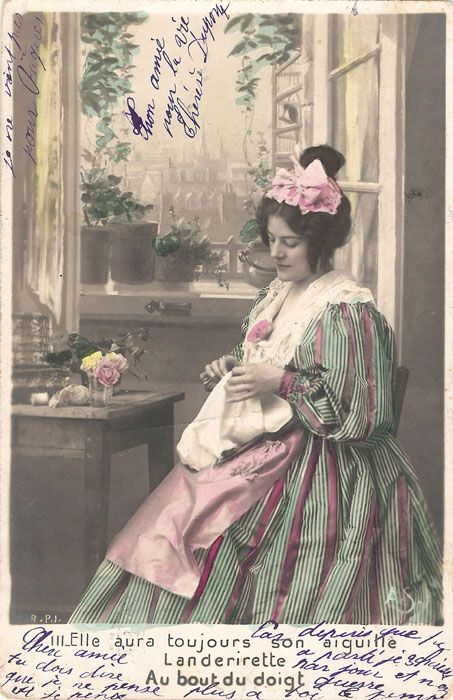 Postcard of a woman sewing postmarked April 2nd, 1904.
