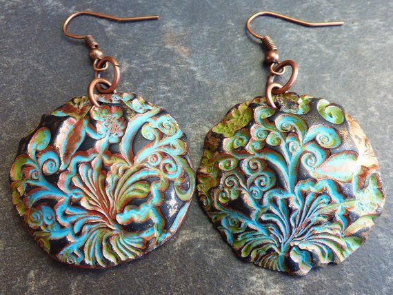 fe3dad8e1 These handmade earrings were crafted from polymer clay and made to imitate  rusted copper and bronze with a layer of patina. They are featuring an  abstract ...