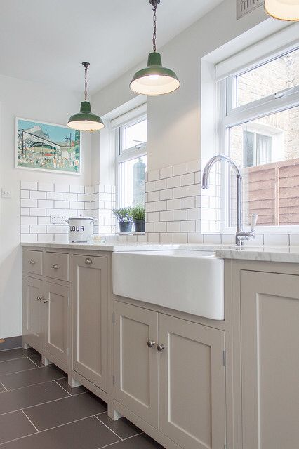 Painted kitchen with white granite worktops