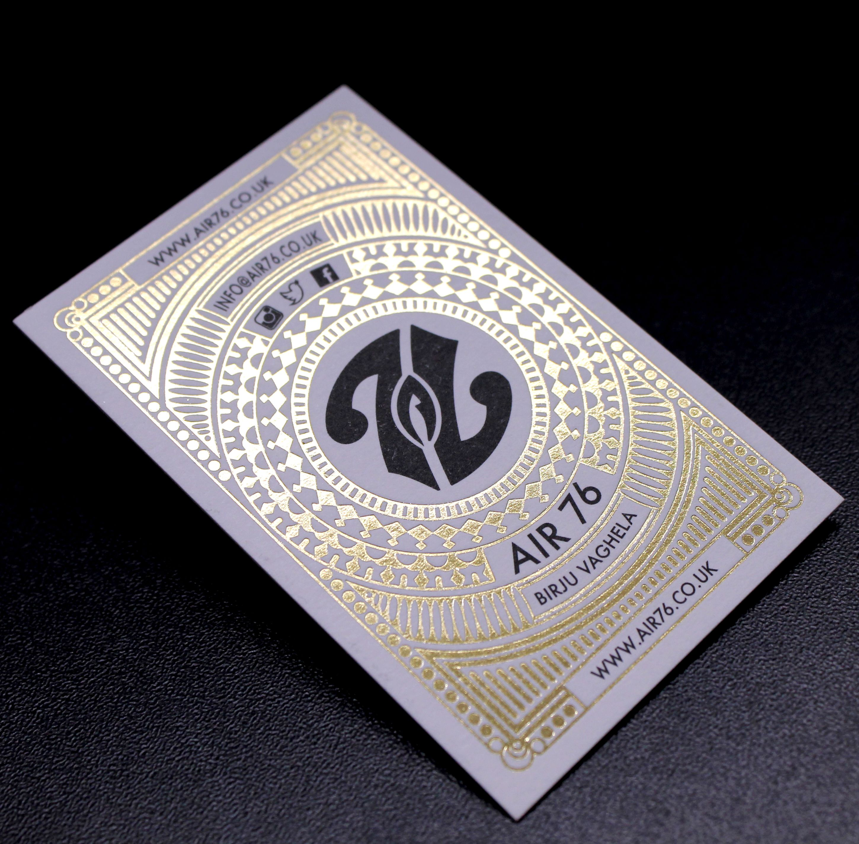Intricate gold foil business cards with black litho printed details ...