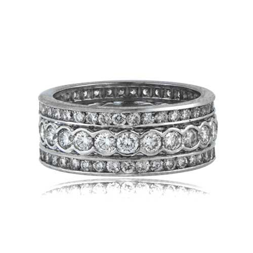 Diamonds are Brilliant-cut and approximately H color, VS clarity. Platinum Diamond Triple Band. This band has total weight of approximately 3.13 carats
