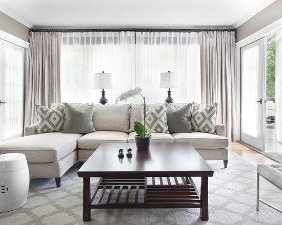 Comfortable Living Room In Grey White With The Area Rug And Pillows Almost An Exact Color Match Large Central Coffee Table Ceramic Asian Garden
