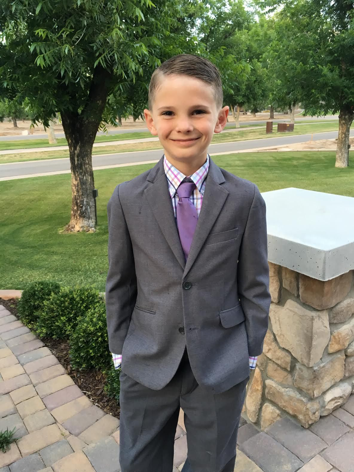 221ab59fbf1c16 Handsome little guy wearing our Black N Bianco Dark Grey Slim suit ...