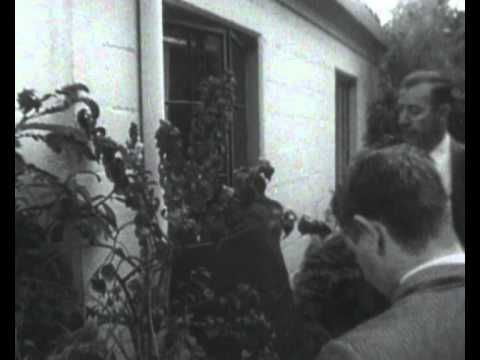 Marilyn Monroe's body being removed from her house. Looking in to the bedroom from outside is eerie in this video.