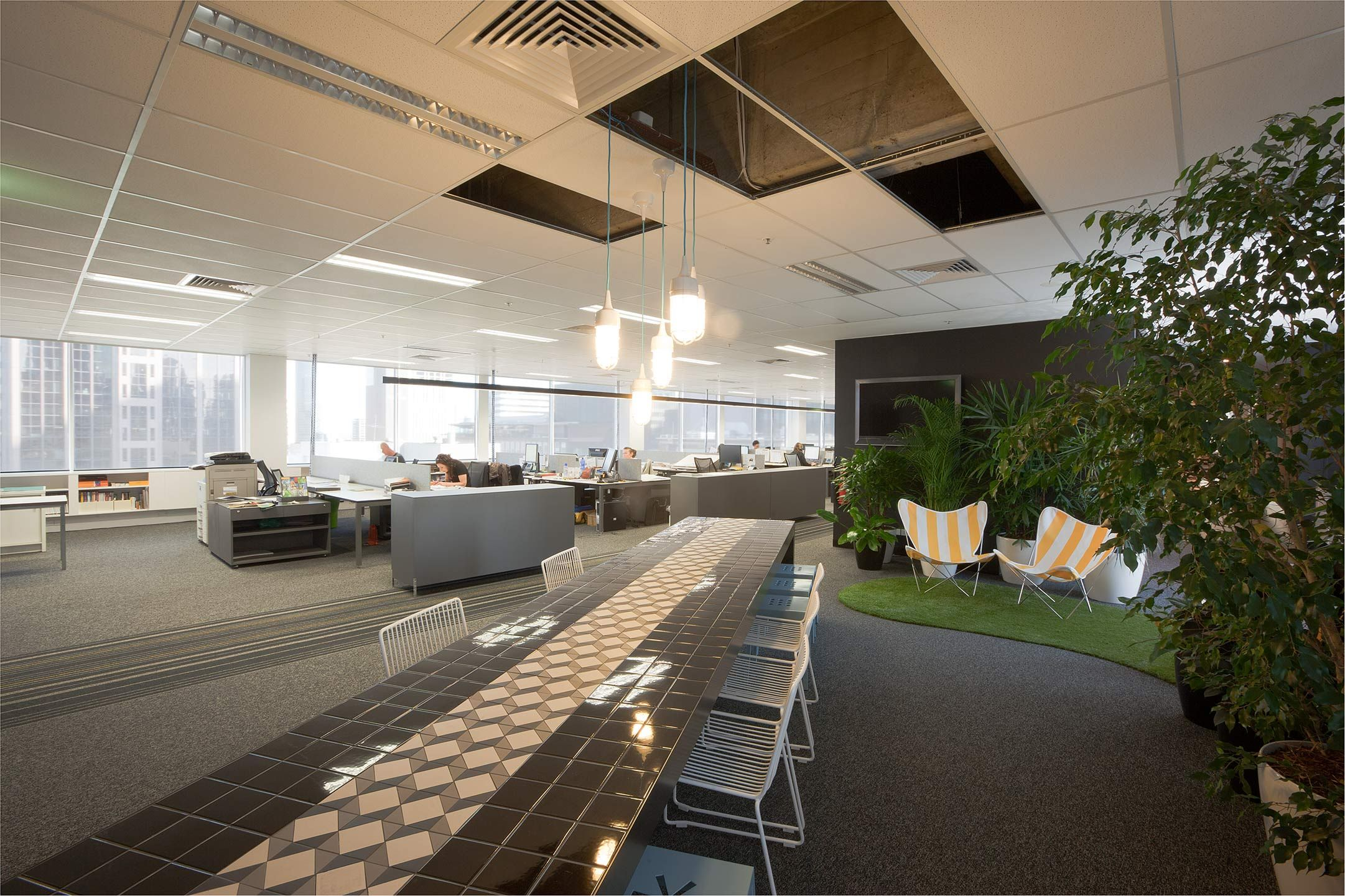 red design group melbourne office creates distinct areas in open