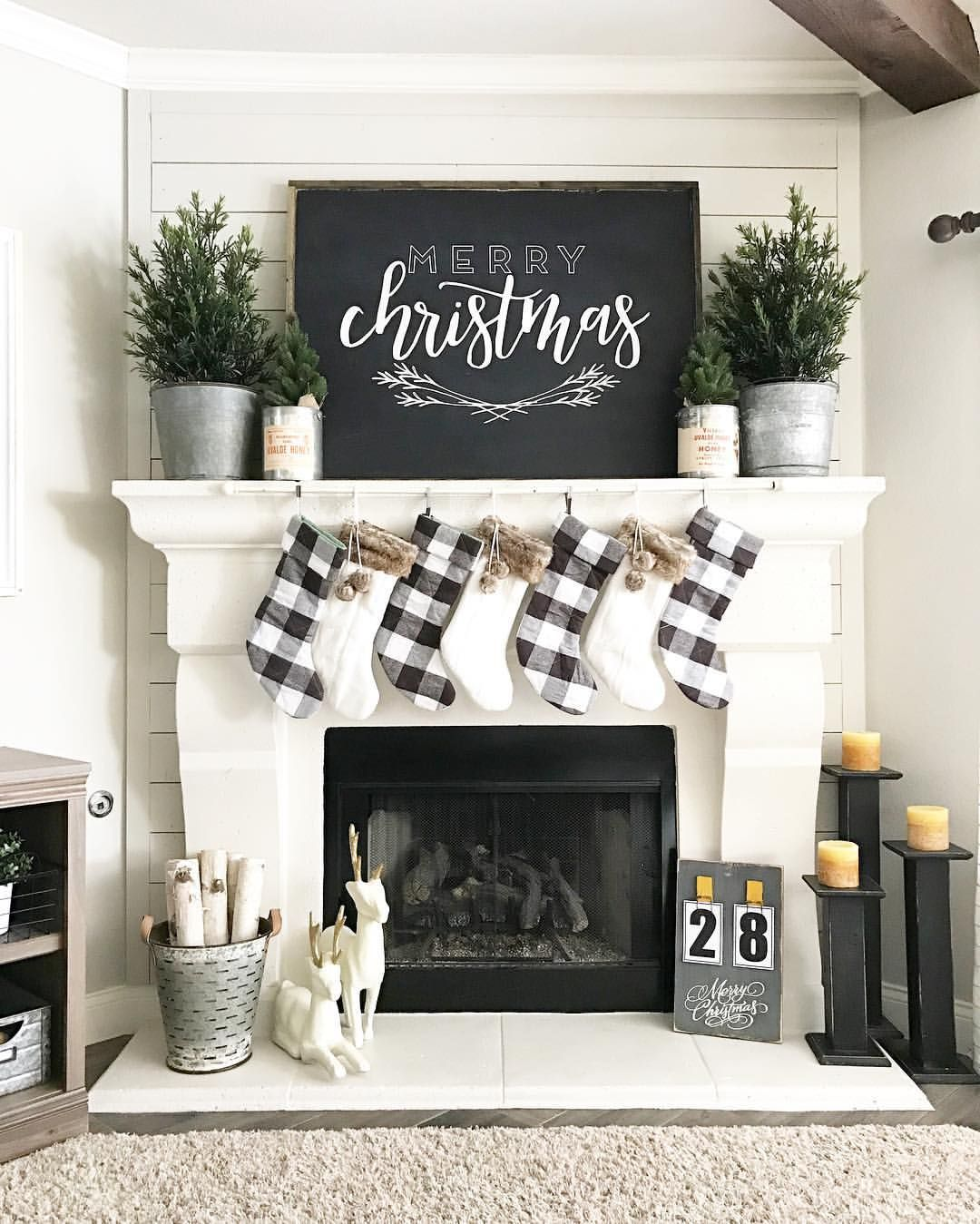 Love this simple black and white Christmas decor • Instagram photo by @ourfauxfarmhouse