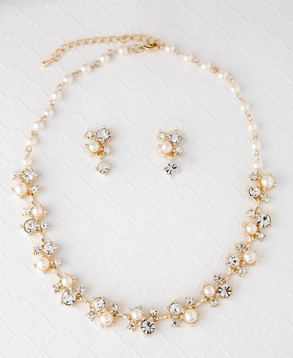Clusters Of Crystal Clear Rhinestones And Ivory Pearls Create This Radiant Bridal Necklace And Earring Set Pearl Jewelry Wedding Wedding Jewelry Bridal Jewelry